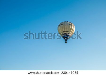 Air balloon flying on the blue sky background - stock photo