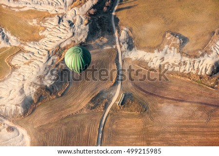 Air balloon landing over growing fields