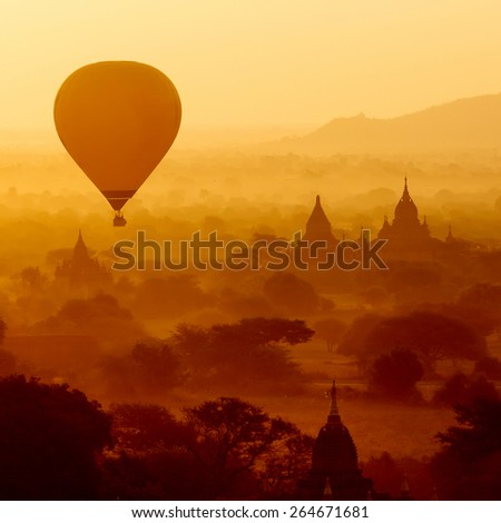 air balloons over Buddhist temples at sunrise. Bagan, Myanmar. - stock photo
