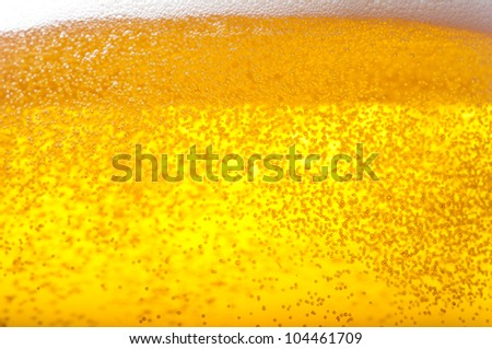Air bubbles in beer and foam.
