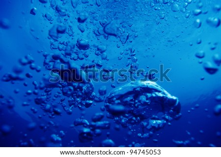 air bubbles in fresh water nice for backgrounds - stock photo