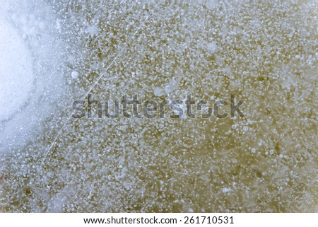 Air bubbles in frozen ice - stock photo