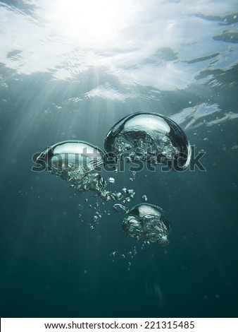 air bubbles under water - stock photo