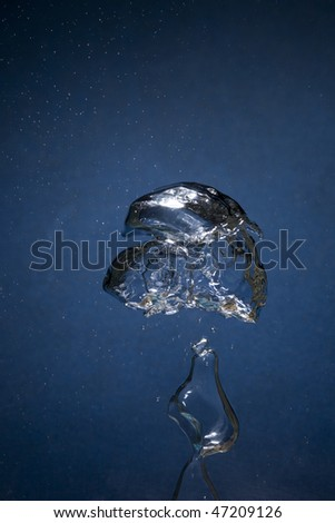Air bubbles underwater isolated on blue background splashing - stock photo
