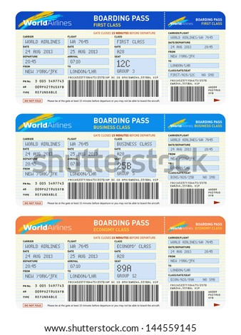 Air business travel transportation concept: group of color airline tickets for first, business and economy class travel isolated on white background - stock photo