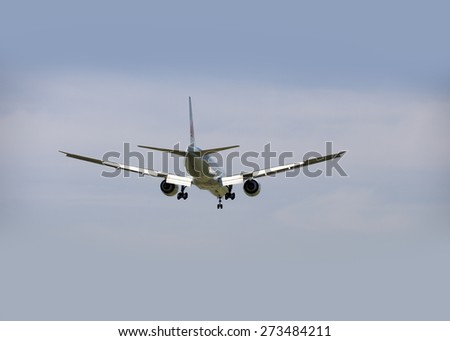 AIR CANADA - MAY 31, 2014: Boeing 777-333, the new two jet engine aricraft was photographed before landing in Vancouver, British Columbia, Canada. The airliner Air Canada cpompany was founded in 1936. - stock photo