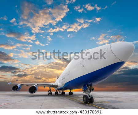 air cargo freighter with nice sky - stock photo