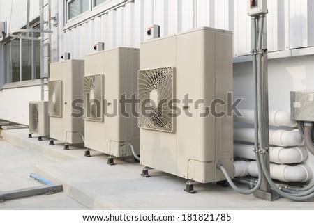 Air compressor installation on pedestal. - stock photo