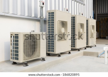 Air compressor installation on pedestal. - stock photo
