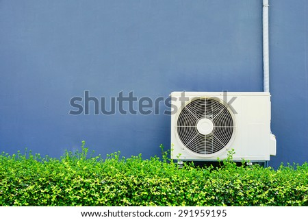Air compressor installation on pedestal.outdoor - stock photo