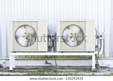 Air compressor is running./Air compressor. - stock photo