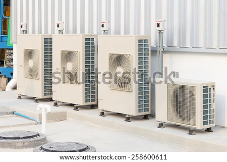 Air compressor machine on pedestal with sky background. - stock photo