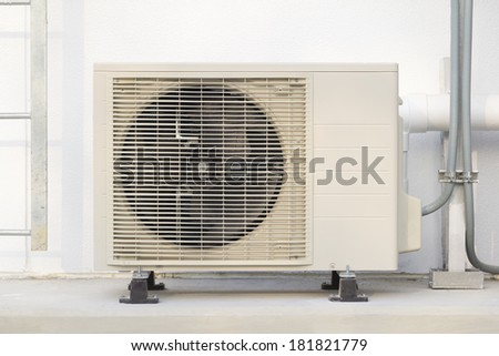Air compressor with wall background. - stock photo