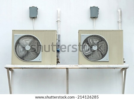 Air compressors on wall - stock photo