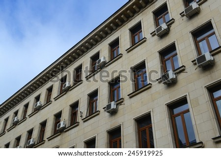 Air conditioner (aircon) in a housing building - stock photo