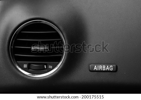 "Air conditioner and The word ""Airbag"" is written on a car's dashboard. Black and White"