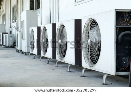 Air conditioner compressor installed in old building - stock photo