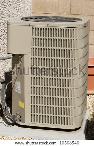 Air conditioner compressor units near residential building
