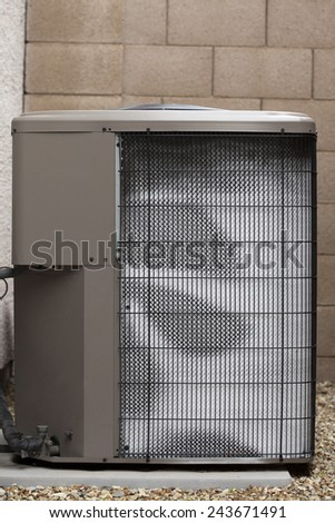 Air conditioner external compressor heat exchange unit (also referred as Heat Pump) covered with white frost on cold and humid January morning - stock photo
