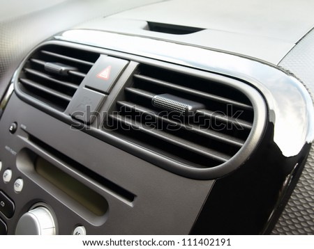 Air conditioner in compact car - stock photo