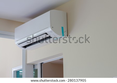 air conditioner install on wall for condo or meeting room - stock photo