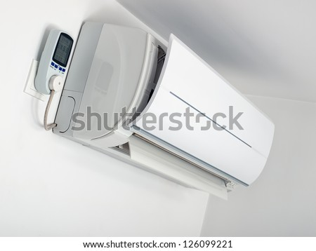 Air-conditioner is plugged on the energy measurement device. - stock photo