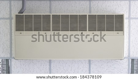 Air conditioner machine bottom side fixing with ceiling. - stock photo