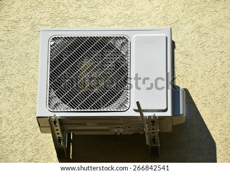 Air conditioner on the wall of a building - stock photo