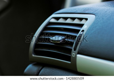 Air conditioner outlet in compact car