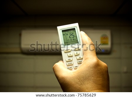 air conditioner remote control set as saving power temperature - stock photo