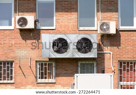 Air conditioners on the wall of a building - stock photo