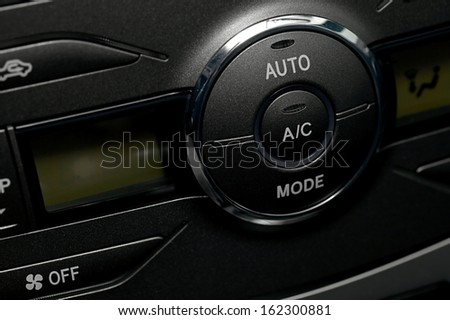 Air conditioning buttons of a car - stock photo
