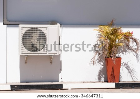 Air conditioning compressor durable under the sunlight - stock photo