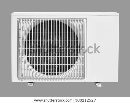air conditioning compressor isolated on gray - stock photo