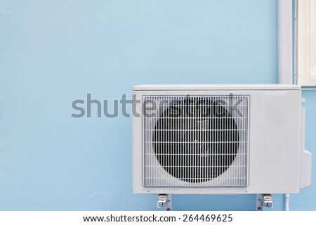 air conditioning compressor on wall