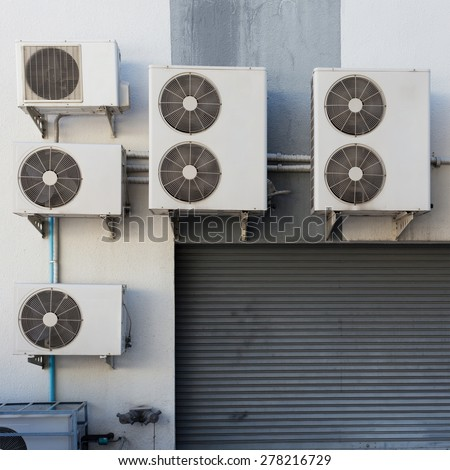 air conditioning compressor system outside the factory - stock photo