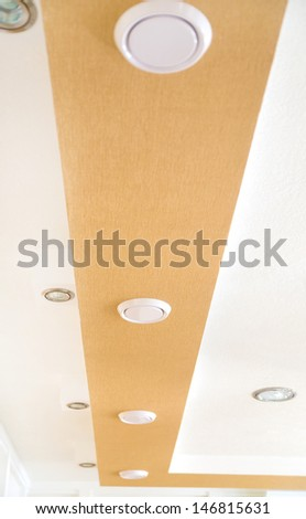 Air conditioning cool air vent fan on ceiling - stock photo