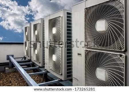 Air conditioning system assembled on top of a building. - stock photo