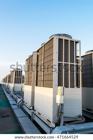 Air conditioning system installed on the roof of the building in the morning