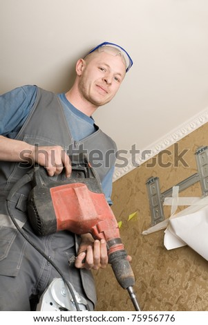 Air conditioning technician holding a drill. Work on installing a new air conditioner. - stock photo