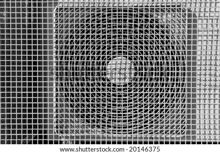 Air conditioning ventilation fan with a mesh grill cover. - stock photo