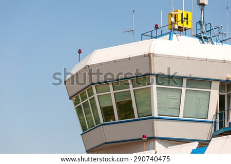 Air control tower in the airport morning light - stock photo