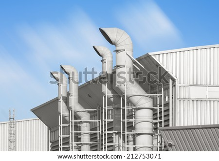 Air duct pipe and roof for industrial with blue sky background.