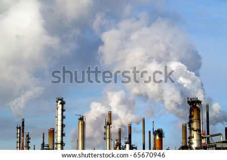 "Air emisions from an oil refinery in the ""heartland"" of Alberta, Canada.  There are billions upon billions of dollars being spent on oil sands development in Northern Alberta. - stock photo"