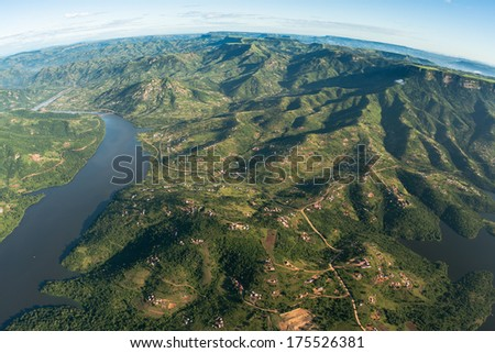 Air Flying Landscape Dam Rural Homes Air flying birds eye view of over Inanda dam valley terrain of thousand hills with homes over colorful landscape