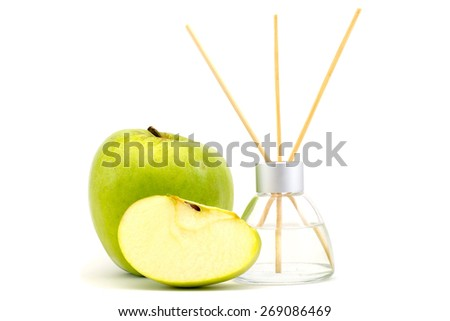 air freshener sticks with a green apple isolated - stock photo