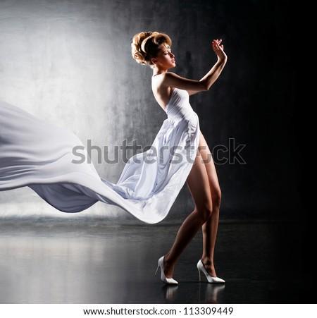 Air girl in fluttering white dress - stock photo