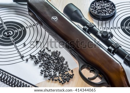 air gun with bullets targets - stock photo