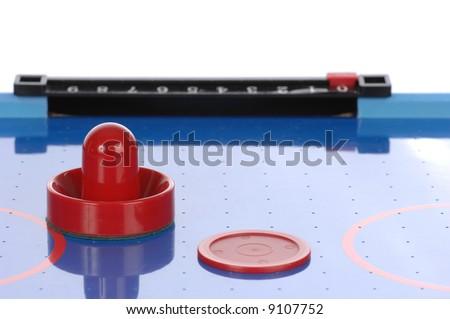 Air hockey paddle and puck - stock photo
