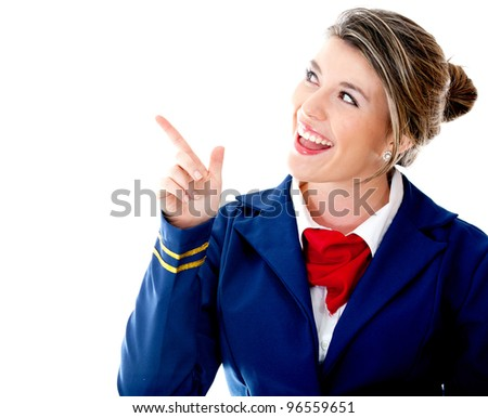 Air hostess pointing  with her finger - isolated over a white background